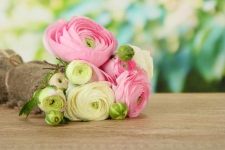 persian green: Ranunculus (persian buttercups) on green background