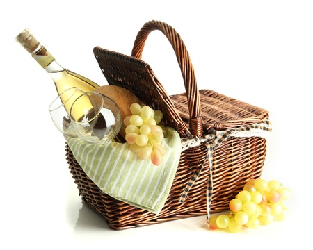 Picnic basket with grape and bottle of wine, isolated on white Standard-Bild