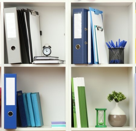 office cabinet: White office shelves with different stationery