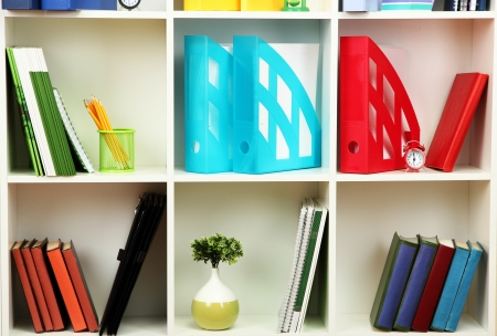 White office shelves with different stationery photo