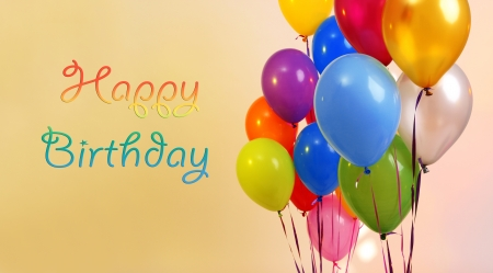Many bright balloons on color background photo