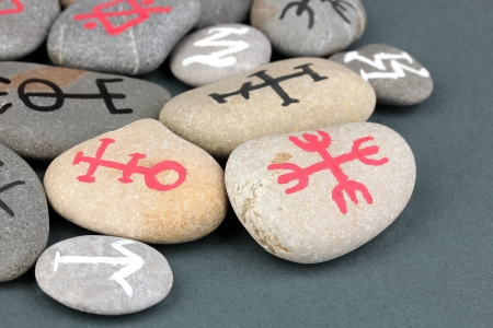 Fortune telling  with symbols on stones on grey background Stock Photo - 19300068