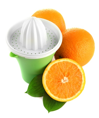 Citrus press and ripe oranges, isolated on white photo