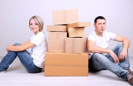 Young couple moving in new house Stock Photo - 21517172
