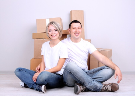 Young couple moving in new house Stock Photo - 21517209