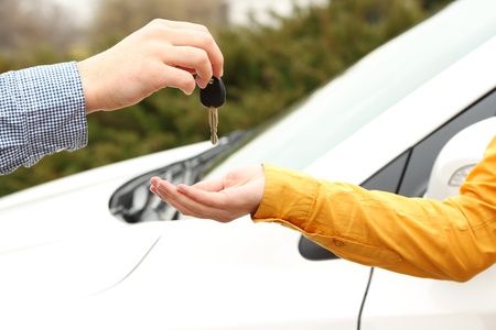 Woman and man hands with car key, close up Stock Photo - 19328645