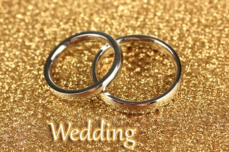 wedlock: Wedding rings on bright background