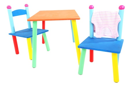 Small and colorful table and chairs for little kids isolated on white Stock Photo - 19300835