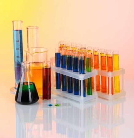 chemical industry: Colorful test tubes on light background