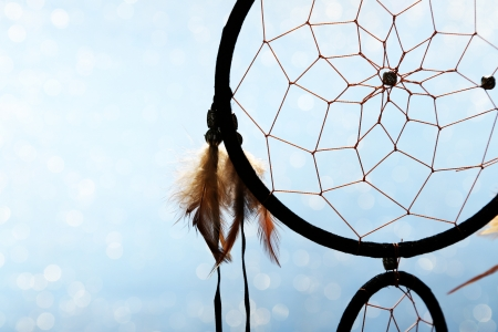 dreamcatcher: Beautiful dream catcher on blue background with lights Stock Photo