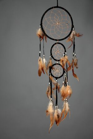 Beautiful dream catcher on grey background photo