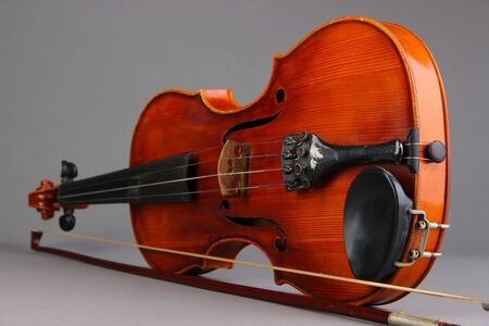 Classical violin on grey background Stock Photo - 19303202