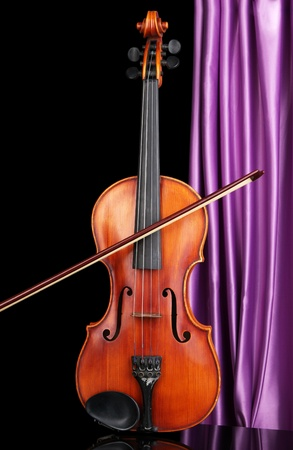 Classical violin on curtain background Stock Photo - 19301549
