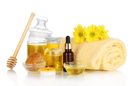 humidify: Fragrant honey spa with oils and honey isolated on white