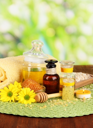 humidify: Fragrant honey spa with oils and honey on wooden table close-up