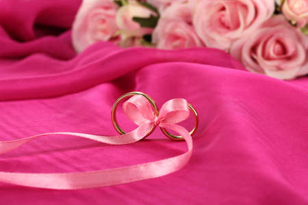 Wedding rings tied with ribbon photo