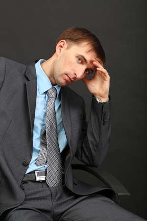 Young businessman ton black background Stock Photo - 21517935