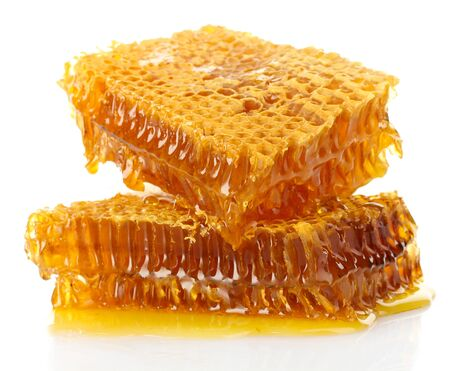 sweet honeycombs with honey, isolated on white photo