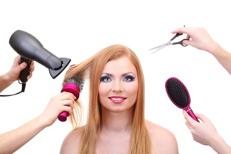 profesional: Beautiful woman and hands with brushes, scissors and hairdryer isolated on white Stock Photo