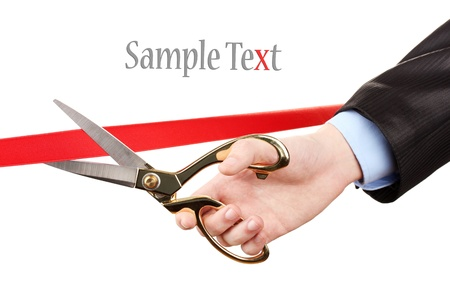 Cutting red ribbon, isolated on white photo