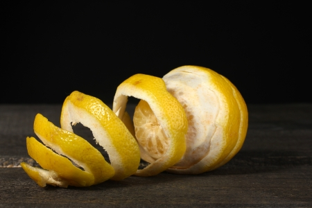 ripe lemons on wooden table on grey background photo