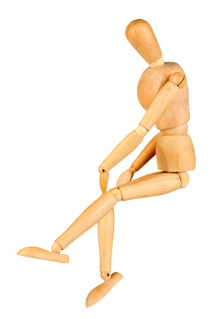 Joint pain at wooden mannequin isolated on white photo