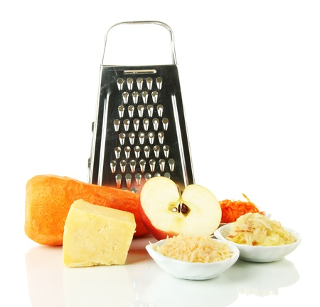 Metal grater and apple, cheese, carrot,  isolated on white photo