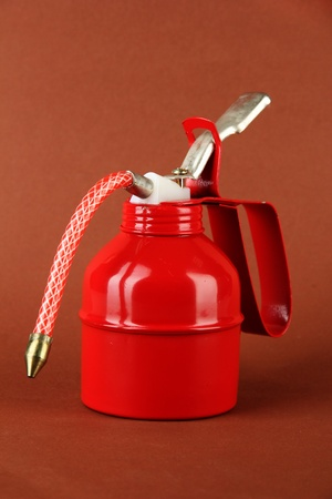 Red oil can, on color background Stock Photo - 19322649