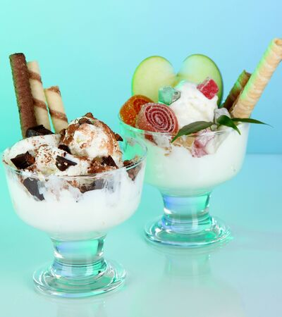 Ice cream with wafer sticks on blue background Stock Photo
