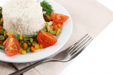 Delicious risotto with vegetables isolated on white photo