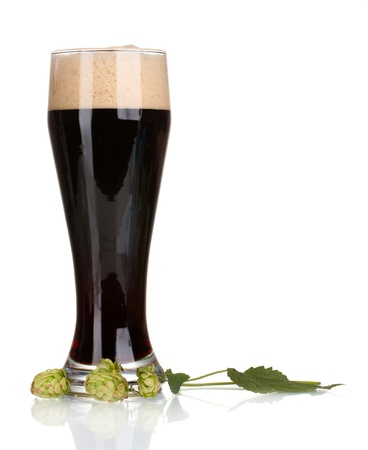 unstrained: dark beer in a glass and green hop isolated on white Stock Photo