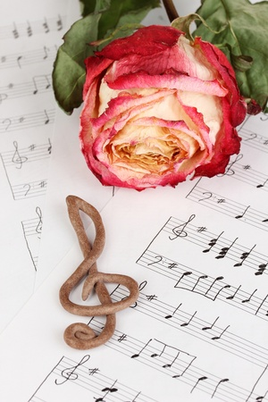 sheetmusic: Treble clef and rose on musical background