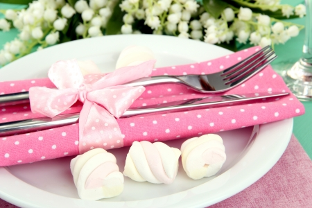 Table setting in white and pink tones on color  wooden background Stock Photo - 19456045