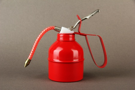 Red oil can, on color background Stock Photo - 19412064
