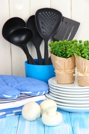 cooking utensils: Kitchen settings: utensil, potholders, towels and else  on wooden table Stock Photo