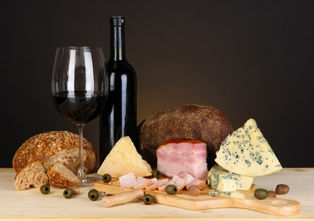 Exquisite still life of wine, cheese and meat products photo