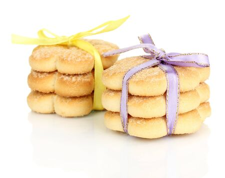 Sweet cookies tied with colorful ribbons isolated on white Stock Photo - 19411589