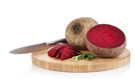 Sliced beetroot on board isolated on white photo