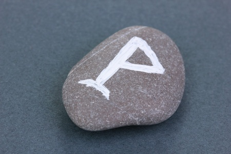 Fortune telling  with symbols on stone on grey background photo
