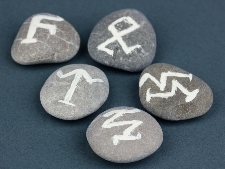 Fortune telling  with symbols on stones on grey background Stock Photo - 19412560