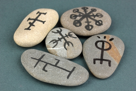 Fortune telling  with symbols on stones on grey background Stock Photo - 19412872