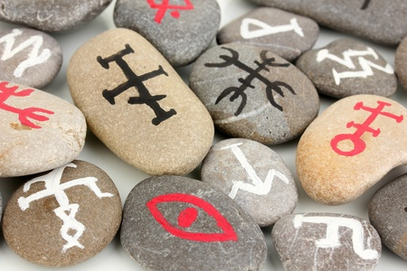 Fortune telling  with symbols on stones close up photo