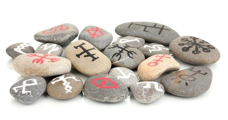 Fortune telling  with symbols on stones isolated on white Stock Photo - 19412076