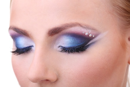 Beautiful female eyes with bright blue make-up photo