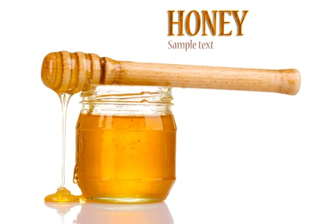 Jar of honey isolated on white photo