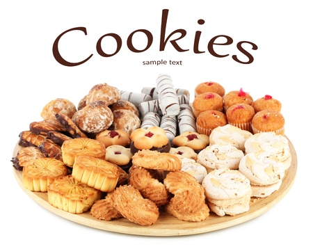 nutritiously: Sweet cookies on wooden plate isolated on white