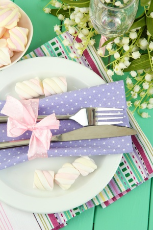 Table setting in violet and white tones on color  wooden background Stock Photo - 19580214