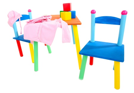 Small and colorful table and chairs for little kids isolated on white Stock Photo - 19579140
