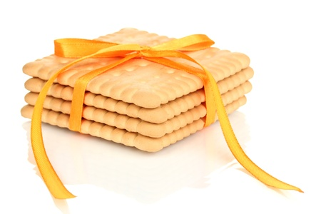 Sweet cookies tied with yellow ribbon isolated on white Stock Photo - 19579164