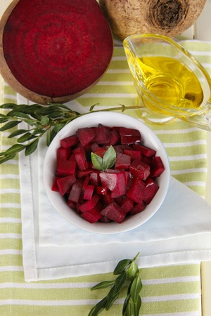 Sliced beetroot on bowl on wooden table close-up photo